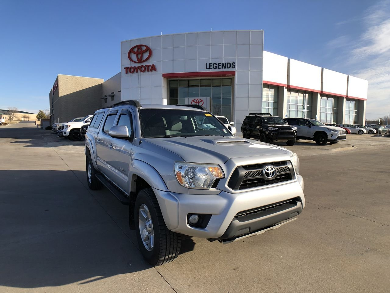 Pre-Owned 2012 Toyota Tacoma 4WD Double Cab V6 AT